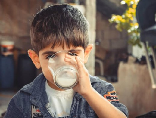 photo-of-boy-drinking-glass-of-milk-1210005